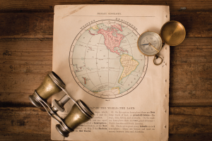Image of vintage map, compass, and binoculars.